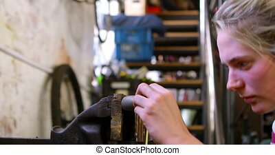 Woman measuring bicycle tool at workshop 4k - Beautiful...
