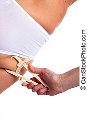 Woman measuring body fat.