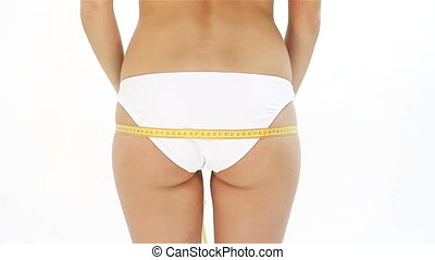 Woman measuring her hip and showing ok sign