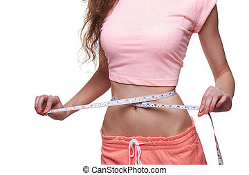 Woman measuring her slim body isolated on white background. Cropped image.