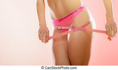 Woman measuring perfect shape of hips. - Closeup woman...