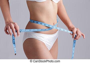 Woman measuring shape of beautiful