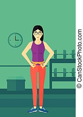 Woman measuring waist.