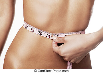 Woman measuring waistline