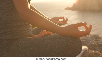 Woman meditates like zen on nature at sunset
