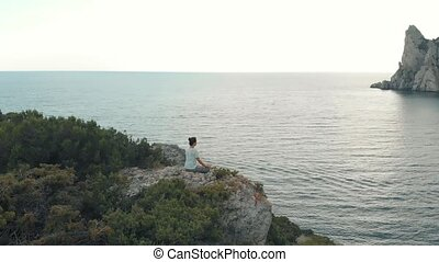 Woman meditates on nature