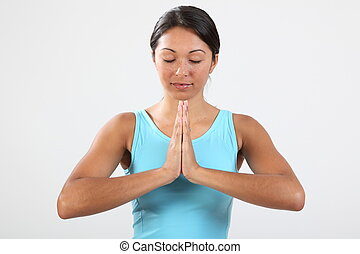 Woman meditating eyes closed