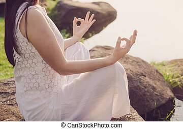 woman meditating in a yoga on natrue