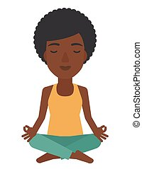 Woman meditating in lotus pose. - An african-american woman...