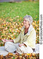 Woman Meditating In Lotus Position