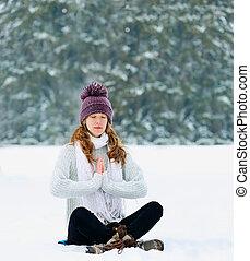 woman meditating in winter