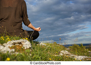 Woman meditating in yoga position