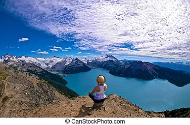 Woman Meditating, Lake, Mountains.