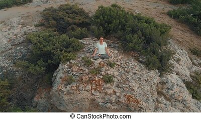 Woman meditating on nature