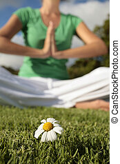 Woman Meditating with Blue Sky and Daisies