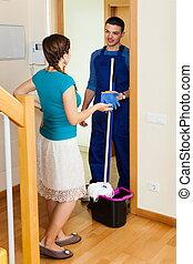 Woman meeting cleaner at door