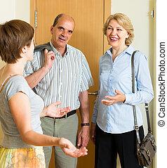 Woman meeting friends at the door