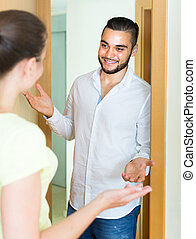 Woman meeting man at the door