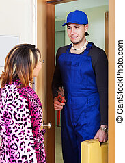 Woman meeting plumber at home