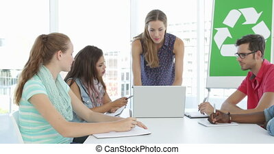 Woman meeting with colleagues about environmental awareness...