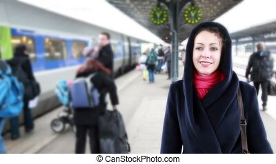 Woman meets on train station, seeking among guests - woman...