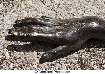 Woman metal hand