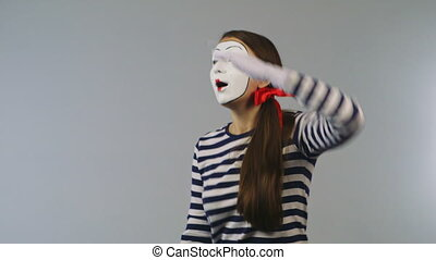 Woman mime looking through binoculars. Concept: Search