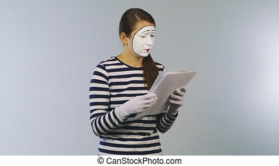 Woman mime reading documents. Bad news