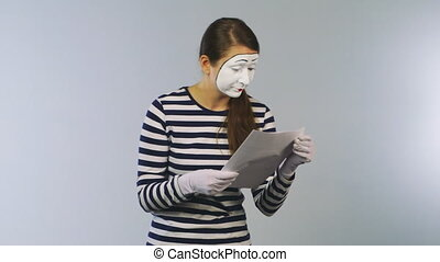 Woman mime reading documents. Funny news