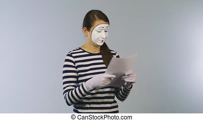 Woman mime reading documents. Surprise news