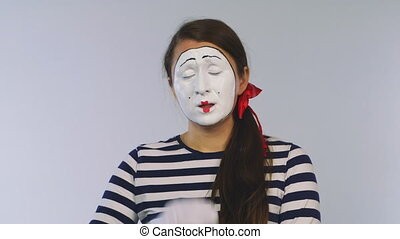Woman mime shows toothache . Toothache. Dental clinic.