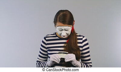 Woman mime with scissors cuts the credit card. Concept: bankruptcy, insolvency