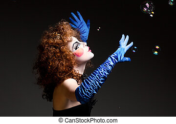 woman mime with soap bubbles. - Woman mime with theatrical...