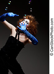 woman mime with soap bubbles. - Woman mime with theatrical ...