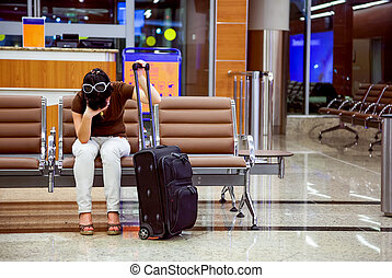 Woman missed the plane - woman was late for a plane at the...