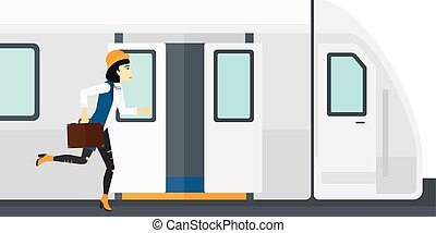 Woman missing train. - Latecomer woman running along the...