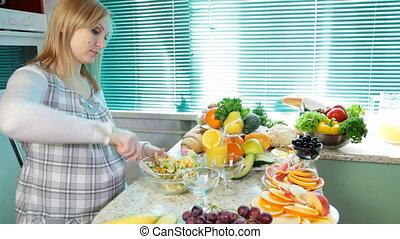 woman mixing fruit salad