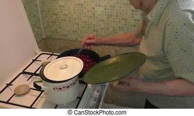 woman mixs in a frying