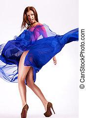 woman model in a fluttering dress screaming