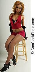 Woman Model posing at a studio photo shoot.