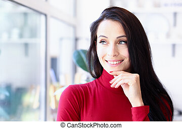 Woman model posing in front of the window
