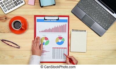 Woman Monitoring Stock Charts - Businesswoman Monitoring...