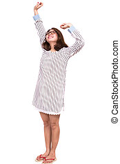 Woman morning stretching in pajamas smiling isolated on white background