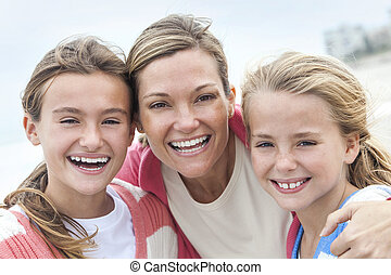 Woman Mother and Girl Children Sisters Happy on Beach