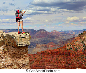 Woman mountain Hiker with backpack enjoy view in grand...