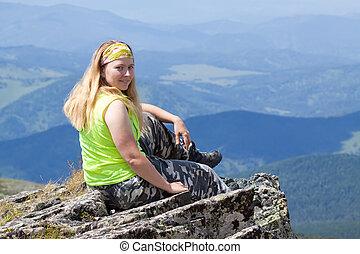 Woman mountain peak