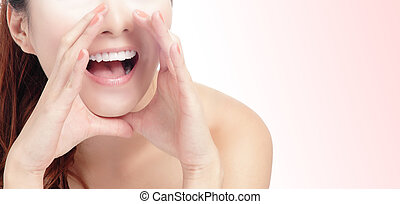 woman mouth whispering with pink background - close up of ...