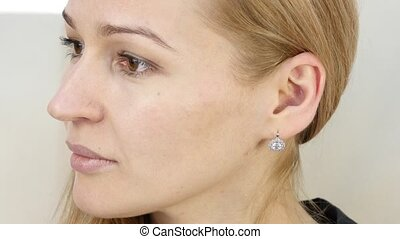 woman moves her ears and doing facial massage after a hard...