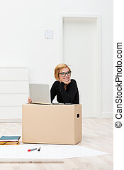 Woman moving home working on a laptop