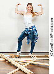 Woman moving into new apartment. Success. - Successful and...